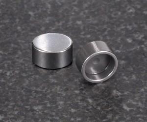Titanium valves, lash caps and pressed-in hard tips: Trying